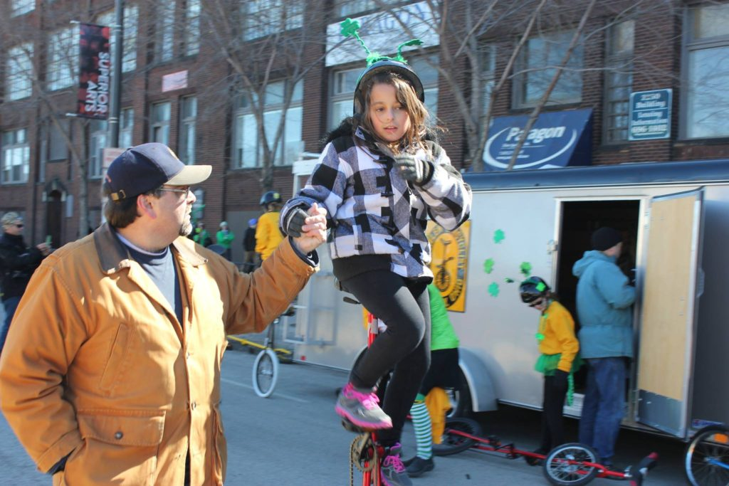Young unicyclists gets a hand